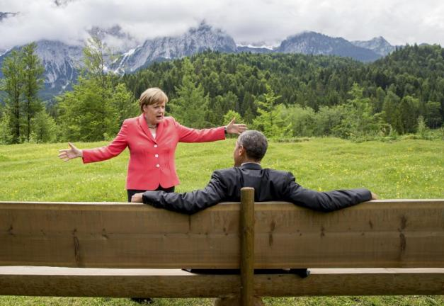 German Chancellor Merkel speaks with U.S. President Obama outside the Elmau castle in Kruen